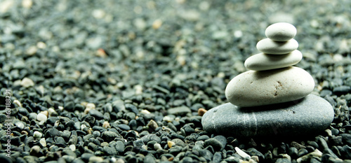 piles of stone beside on black stone background