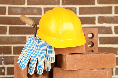 canvas print picture New bricks and building tools on brick wall background