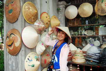 Traveler Thai Woman with hat vietnam style at Hanoi