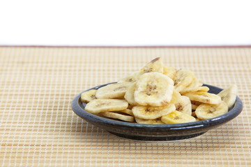 Banana chips, made from dehydrated slices of fresh ripe bananas