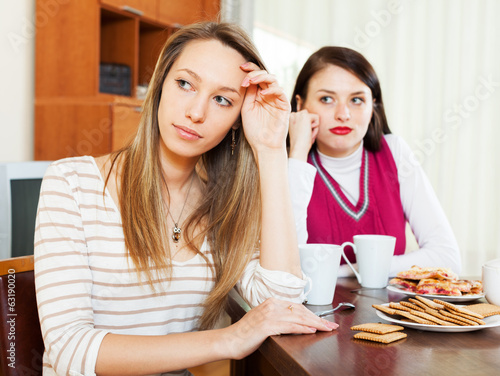 Two  women after quarrel at table
