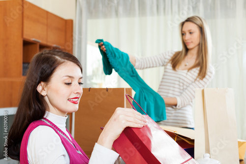 women looking purchases from shopping bags