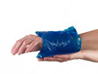 Cool gel pack on a swollen hurting wrist.