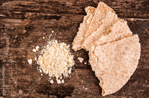 making pita bread on a wood background