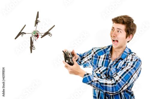 Leinwanddruck Bild man crashing a quadcopter drone