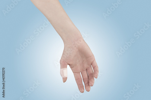 Adhesive Healing plaster on finger.