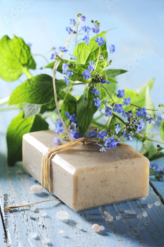 natural soap with flower on a wooden table