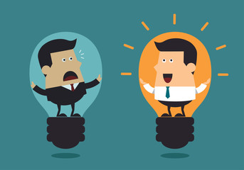 Boss and young businessman with big light bulbs, Business concep