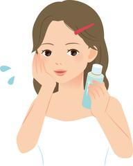 化粧水を肌に付ける女性