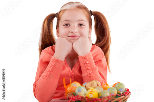 funny girl with freckles and pigtails and a basket of Easter egg
