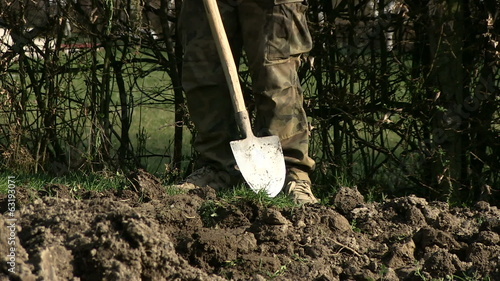 Man digging ground in his garden