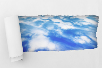 White Torn paper with sky