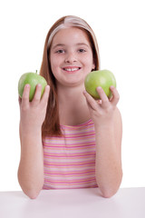 redhaired  girl with two green apple,on white background