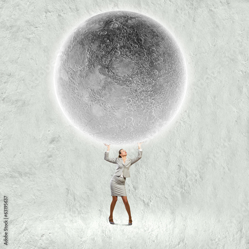 Businesswoman lifting moon