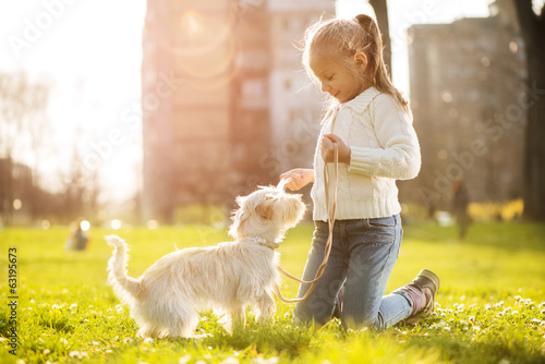 canvas print picture Little girl with her puppy dog
