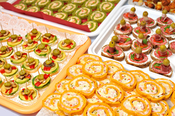Plate of many mini size sandwich appetizers