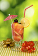 image of cocktail on green background