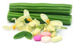 Moringa pills with flower and leaves