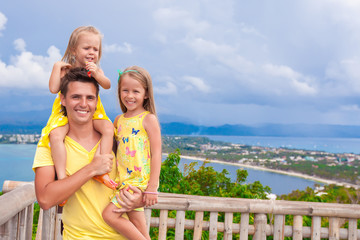 Dad with his daughters at observation deck on the background of