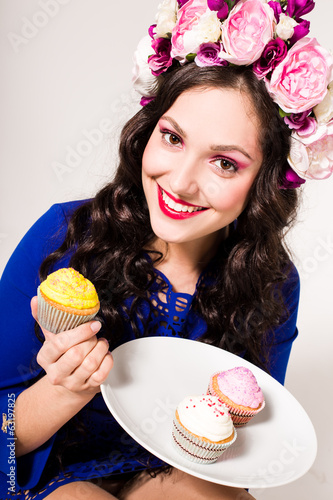 curly brunette with sweets