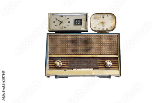 oldie radios and clock on white background