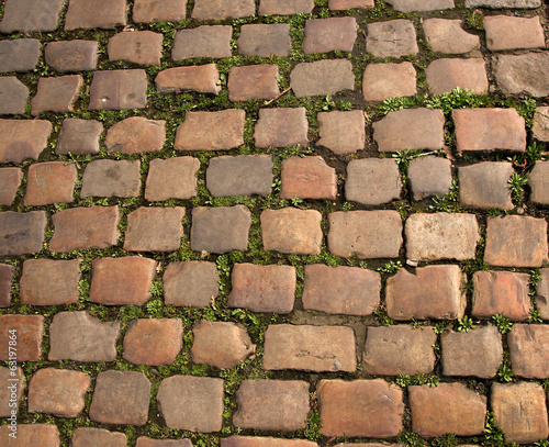 this is old pavement from stone cubes for cars
