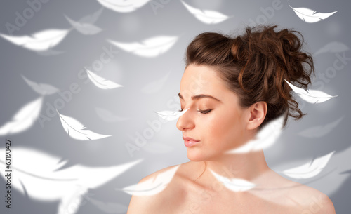 Beautifull young girl with light feather skin concept