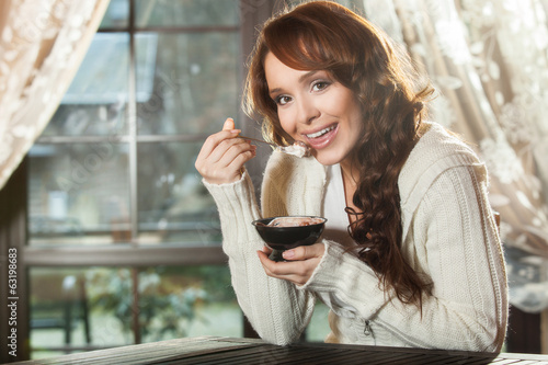 Young woman eating a dessert
