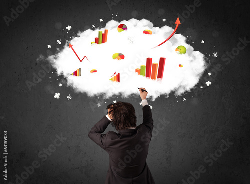 Businessman with charts in a cloud above his head