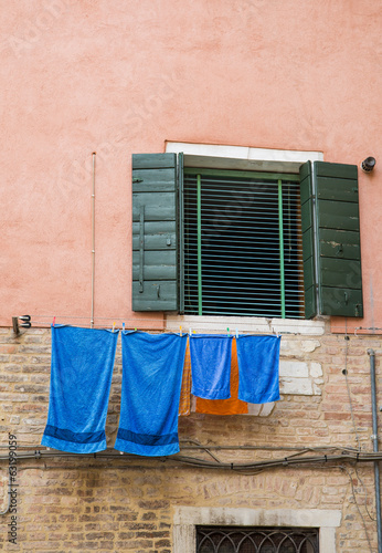 Blue Towels on Pink Stucco
