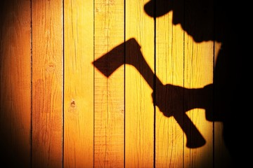 Human Silhouette with Axe in shadow on wooden background, XXXL