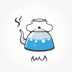 Kettle with boiling water on fire