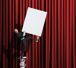 Clown balancing with blank poster