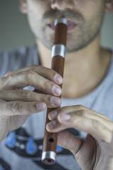 Wooden flute player