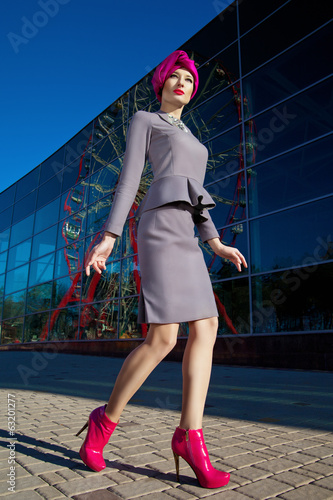Beautiful woman in front of a building