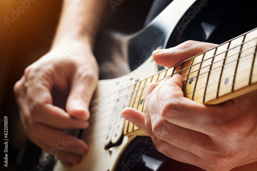 Man playing guitar. Close-up view © efired