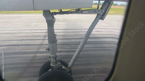 View from the cabin porthole of an airplane during take-off.