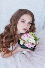 beautiful bride with wedding bouquet