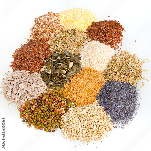 Assorted dried culinary seeds in piles