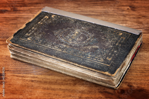 antique book over wooden table