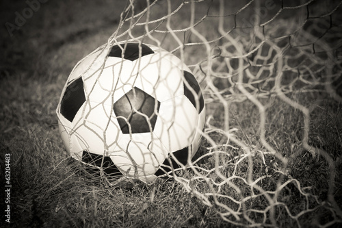 Black and white : Soccer ball in the goal net