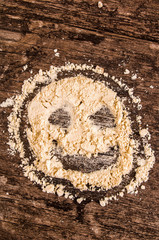 happy face pita bread on a wood background