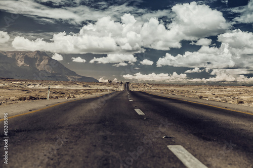 Foto op Plexiglas Zandwoestijn Vintage photo. Road through the desert.