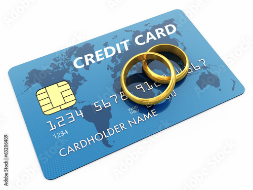 Golden wedding rings and credit card isolated