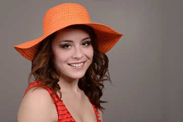 teen girl wearing orange hat