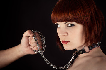 portrait of a beautiful woman on a leash