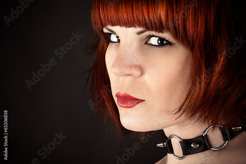 portrait of a beautiful woman with a collar on the neck