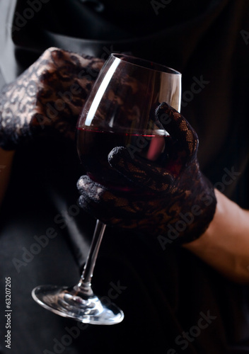 woman in black  with red wine