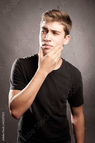 young man with pensive expression