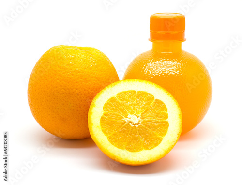 Orange slice and a bottle of fresh orange juice